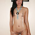 Real asian go go girl Maria poses in her skimpy outfit - image 2