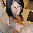 Wicked mixed girl Alyra shows her tattoos and piercings - image 2