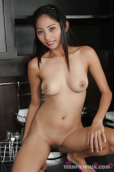 Busty and hot filipina girl strips out of her cutoffs