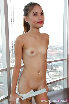 Skinny and hot filipina cutie chris posing in the window