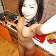 Pierced nipples on slim Chinese girl friend - image 2