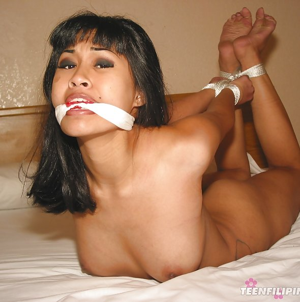 Cute Amerasian girl does sexy BDSM cosplay